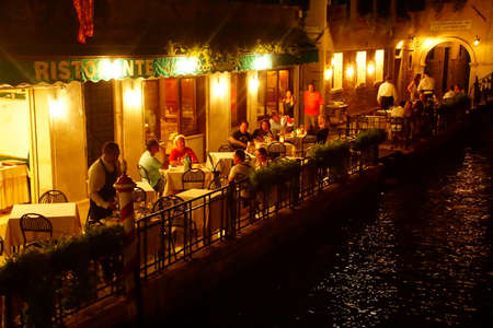 VENICE, ITALY - AUG 12, 2018 - Nighttime diners at a restaurant in Venice, Italy