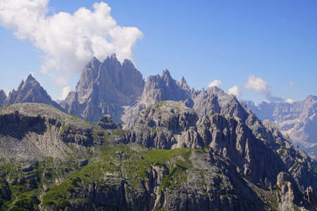 Rows of jagged peaks and green meadows of the Dolomites Alps, Italy Reklamní fotografie