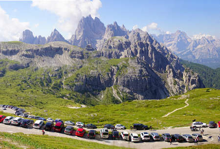 DOLOMITES, ITALY - JUL 31, 2018 -  Parking lot fills with hikers in the Drei Zinnen area of the Dolomites Alps, Italy Editorial
