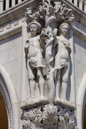Sculpture of Adam and Eve on an exterior corner of the Doges Palace in Venice, Italy
