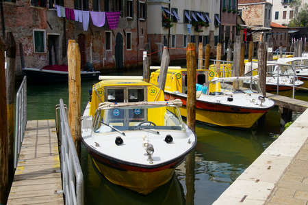 VENICE, ITALY - AUG 11, 2018 - Emergency ambulance motorboats on a canal in Venice, Italy