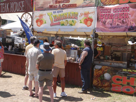 PORTLAND, OREGON - JUL 5, 2018 - Music fans visit the food stalls at the Waterfront Blues Festival, Portland, Oregon