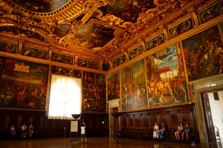 VENICE, ITALY - AUG 13, 2018 - Elaborate gilded decorations of ceiling in the Doges Palace in Venice, Italy Редакционное