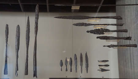 COLOGNE, GERMANY - SEP 15, 2016 - Ancients sword blades and other weapons from an archaeological dig,  Roman - Germanic Museum,  Cologne, Germany Archivio Fotografico - 108847360