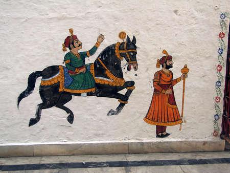 UDAIPUR, INDIA - DEC 2, 2009 -Caparisoned horse on parade. painted on palace walls, , Udaipur, India