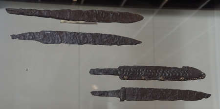 COLOGNE, GERMANY - SEP 15, 2016 - Ancients sword blades and other weapons from an archaeological dig,  Roman - Germanic Museum,  Cologne, Germany Archivio Fotografico - 108847299