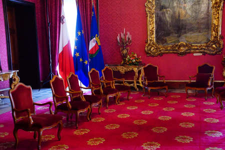 VALLETTA, MALTA - APR 11, 2018 - Red room of state meetings in the Grand Masters Palace, Valletta, Malta