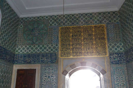 ISTANBUL, TURKEY  - MAY 18, 2014 -  Tiled mosaic wall  in the Harem  in Topkapi Palace,  in Istanbul, Turkey