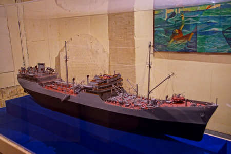 VALLETTA, MALTA - APR 11, 2018 - Model of USS Ohio tanker famous for 1942 convoy run in World War II siege, Malta Maritime Museum, Birgu Vittoriosa, Malta