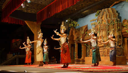 SIEM REAP, CAMBODIA - FEB 14, 2015 - Line of apsara dancers perform at a recital,  Siem Reap,  Cambodia Redactioneel