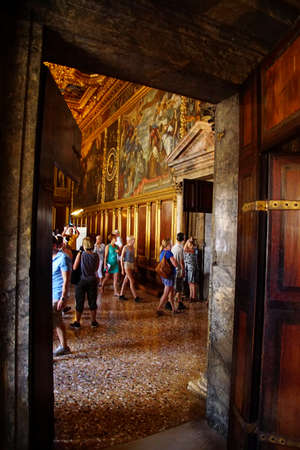 VENICE, ITALY - AUG 13, 2018 - Historical paintings on walls of huge golden meeting hall in the Doges Palace in Venice, Italy 에디토리얼
