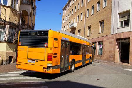 BOLZANO, ITALY - JUL 26, 2018 - Local bus on narrow street of Bolzano, Italy
