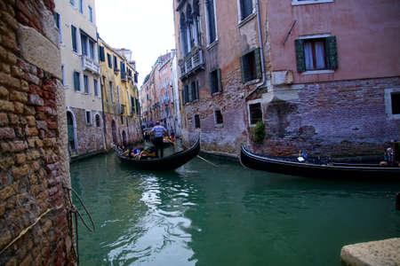 VENICE, ITALY - AUG 10, 2018 - Gondola in small canal of Venice, Italy