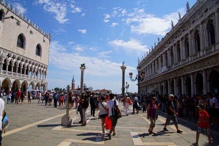 VENICE, ITALY - AUG 10, 2018 - Tourist stroll in piazza near  the Doges Palace in Venice, Italy Editorial