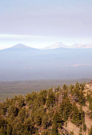 Morning haze on the Three Sisters and other Cascade volcanic peaks, aerial view from Paulina Peak, Newberry National Volcanic Monument, Oregon