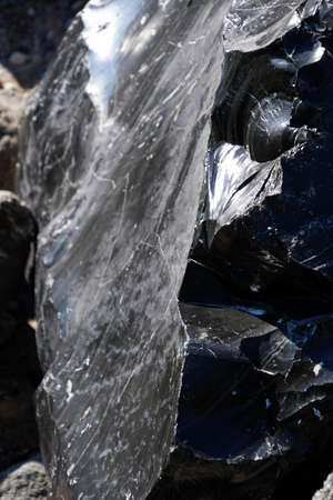 Large chunks of black obsidian glass exposed in the Newberry National Volcanic Monument, Oregon Stock Photo - 110725463