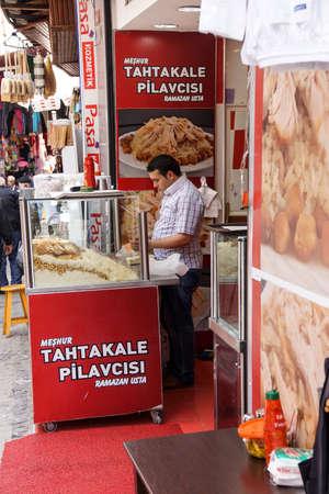 ISTANBUL - May 14, 2014 - Pilaf vendor in the Grand Bazaar (Kapali carsi ) in Istanbul, Turkey Editorial