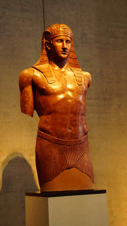 MUNICH - JUL 21, 2018 - Egyptian influence in striding statue of Antinous, favorite of Roman emperor Hadrian, Egyptian Museum, Munich, Germany Editorial