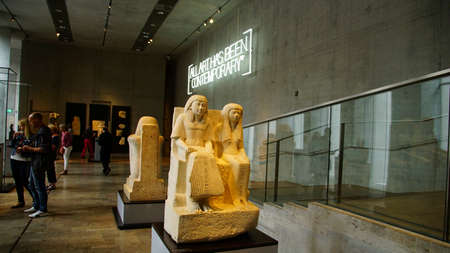 MUNICH - JUL 21, 2018 - Seated funerary figures in Egyptian Museum, Munich, Germany Editorial
