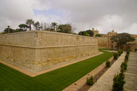 Old fortification walls and moat of Mdina, Malta Stock Photo