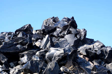 Large chunks of black obsidian glass exposed in the Newberry National Volcanic Monument, Oregon Stock Photo - 112367764