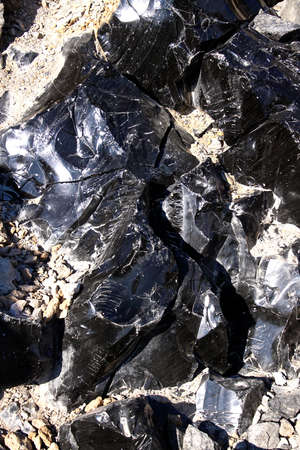 Large chunks of black obsidian glass exposed in the Newberry National Volcanic Monument, Oregon