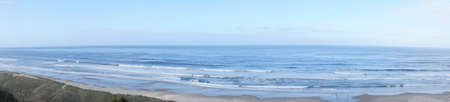 Panorama of sandy beach and dunes along the Pacific coast of Oregon