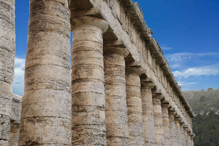 Doric columns of the unfinished Greek temple at Segesta, Sicily, Italy 스톡 콘텐츠 - 114304438