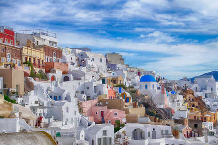 Classic Greek white and blue buildings on the slopes of the volcano caldera in Oia, Santorini, Greece Фото со стока - 114306395