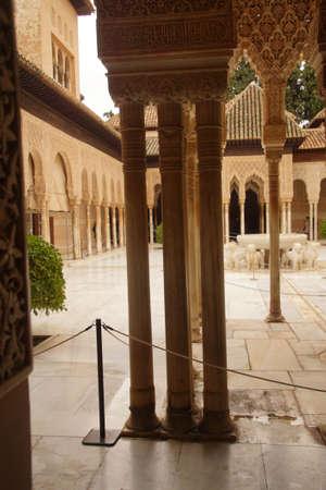 GRENADA, SPAIN - NOV 23, 2018 - Slender columns surround an interior garden of the Alhambra Palace, Grenada, Spain