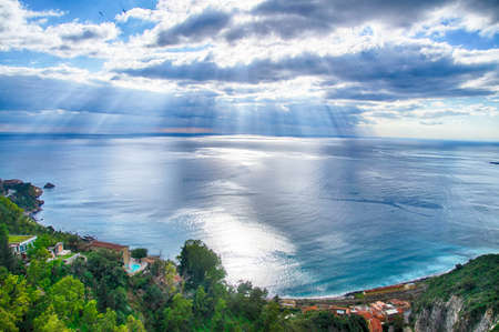 Looking out over the Strait of Messina from high in Taormina, Sicily, Italy