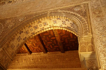 GRENADA, SPAIN - NOV 23, 2018 - Stucco arch and ceiling of Alhambra Palace, Grenada, Spain