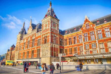AMSTERDAM, NETHERLANDS - DEC 13, 2018 - Centraal Railroad Station building and tram lines, Amsterdam, Netherlands Editoriali