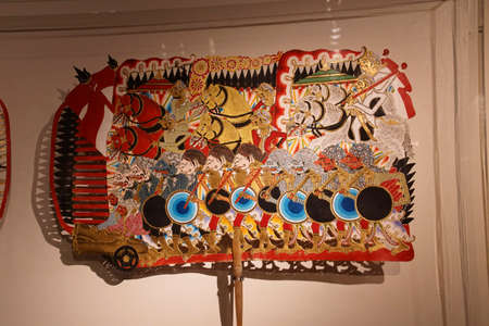 AMSTERDAM, NETHERLANDS - DEC 12, 2018 - Wayang puppets of Dutch colonial army and Javanese during Java War, Tropen Museum, Amsterdam, Netherlands