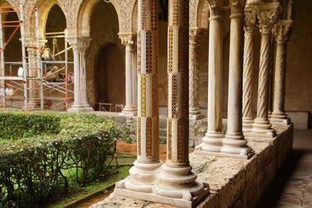MONREALE, SICILY - NOV 28, 218 - Inlaid marble mosaics on slender columns of the cloister of Cathredral Monreale, Palermo, Sicily, Italy Redakční