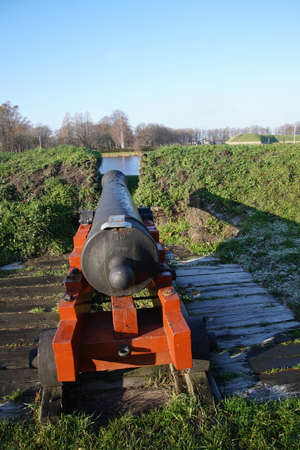 Cannon in casement of fortifications of Naarden, Netherlands Redakční