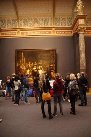 AMSTERDAM, NETHERLANDS - DEC 14, 2018 - Visitors view and photograph Rembrandts Night Watch  in the Rijks Museum, Amsterdam, Netherlands