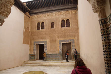 GRENADA, SPAIN - NOV 23, 2018 - Elaborate Islamic designs on interior courtyard of the Alhambra Palace, Grenada, Spain 에디토리얼