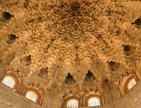 GRENADA, SPAIN - NOV 23, 2018 - Stalactite modeling on ceiling  of the Alhambra Palace, Grenada, Spain