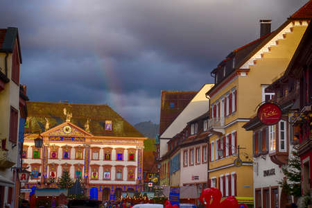 GEGENBACH, GERMANY - DEC 20, 2018 - Rainbow behind the decorated Advent house at the Christmas market,Gegenbach, Germany
