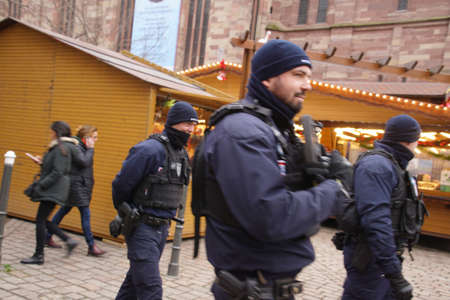 STRASBOURG, FRANCE - DEC 20, 2018 - Gendarme police with automatic weapons on patrol a few days after a terrorist attack in Strasbourg, France Editorial