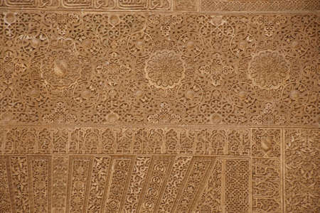 GRENADA, SPAIN - NOV 23, 2018 - Islamic patterns on the wall of the Alhambra Palace, Grenada, Spain Editorial