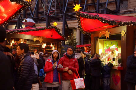 COLOGNE, GERMANY - DEC 17, 2018 - Visitors in early evening explore the Christmas market,Cologne, Germany Editorial