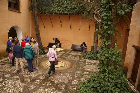 GRENADA, SPAIN - NOV 23, 2018 - Arabic style  interior garden  with fountain in the Alhambra Palace, Grenada, Spain Editorial