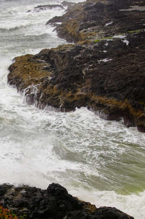 Ocean waves channeled into narrow gorge at the Devils Churn near  Newport, Oregon