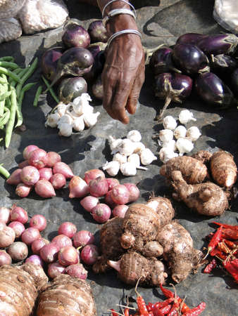 Potatoes and  eggplant for sale  in weekly market in Orissa,  India 写真素材
