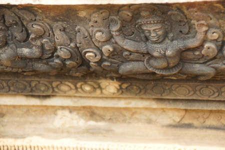 Dvarapala guardian statues holding up a wall,  Angkor Wat,  Siem Reap, Cambodia