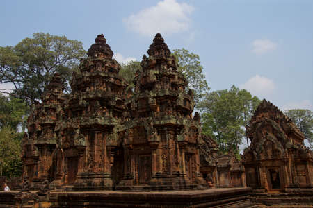 Intricate stone carving on red sandstone doorways and portals,  Banteay Srei, Cambodia