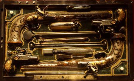 PARIS - DEC 5, 2018 - Fancy set of dueling pistols in the Les Invalides Army Museum, Paris, France