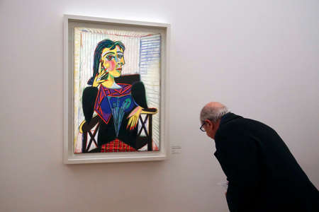 PARIS - DEC 6, 2018 - Visitors examine the artworks in the Picasso National Museum, Paris, France